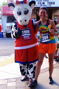 Main Street Mile 2012 Laura wearing Moc3's posing with Vibram shod Meadow Gold cow