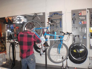 Adam Haynes, one of the owners of Rolling H Cycles, hard at work, still answers my questions.
