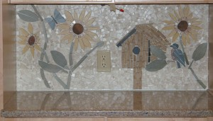 birdhouse and butterfly part of tile mosaic
