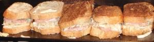 fresh homemade sauerkraut in Reuben sandwiches on the griddle