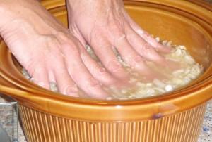 pressing the future sauerkraut into the brine