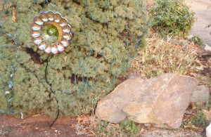Two more gift suggestions:  landscaping rock and unique garden art made from antique glass dishes
