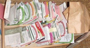 alphabetized seeds packets, separated first as vegetables and flowers