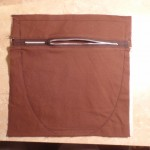 zipper section of pocket is sewn to the back facing