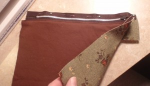 sew pocket zipper to narrow section of main fabric, right sides together