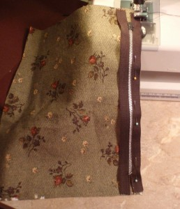 sew zipper to main fabric with right side of fabric against right side of zipper (pull tab against fabric)