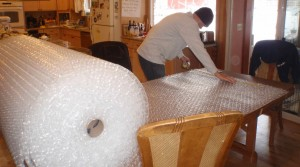 a young engineer at work with bubble wrap
