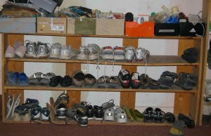 shoe shelf in garage needs a re-organziation, boxes on top are for gloves