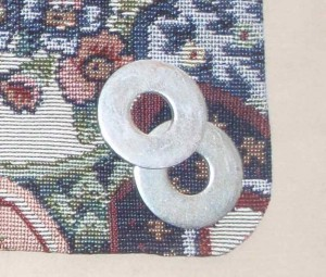 1.25 inch diameter metal washers used to weight purse flap