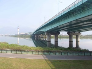 The Zhoumei Freeway bridge over the Danshui River; tower to the left.