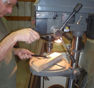 the drill press makes it look easy to poke holes in metal