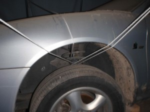 how to tie a portable garage to a Ford Taurus under the tires