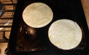 corn tortillas on the griddle
