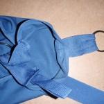 examining tabs on original arm sling