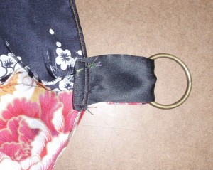 view of upper elbow tab from inside of sling folded up and stitched