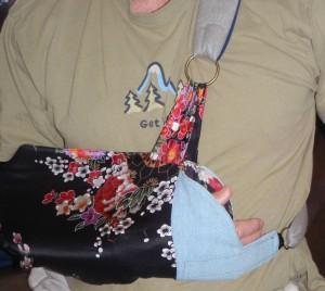 silk sling with denim stabilizing tab near fingers