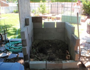 a simple stacked brick compost bin