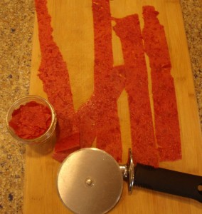 A pizza cutter is a handy tool for cutting your tomato leather down to size.