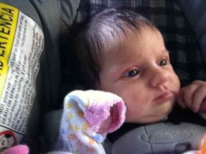 Cori Lou is not so sure about her first ride in car.