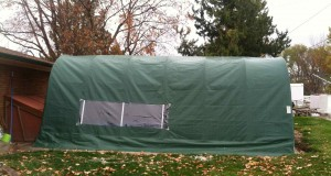 portable garage used as winter cover for outdoor swimming pool so that it can be used comfortably during the cold months.