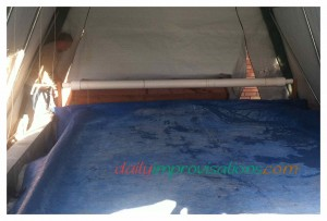 The string was wrapped and tied to bolts in the main roller of the retractable hand crank swimming pool cover.