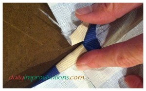 I stopped the seams about 1/2 inch from the edge so that it would be smoother sewing the side panels together as a box.