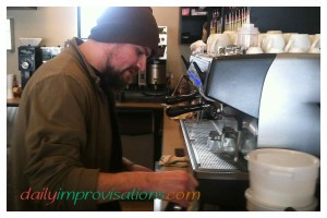 The barista enjoys his work.