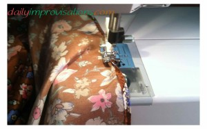 Sewing a very narrow rolled hem at the leg openings.