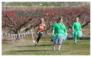 Shamrock Shuffle 2014 - Hitting the grassy final stretch at a full on barefoot sprint. (I don't even remember those ladies there. Probably 5K walkers.)