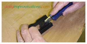 The shop knife cuts through the last thin layer of plastic easily.