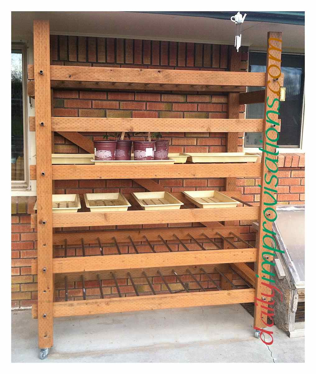 Weather Resistant Shelves For Many Trays Of Seedlings, Up Next To The House  On Our