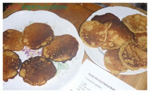 Two plates of pancakes, pre-buttering of the ones I will eat first on the left.