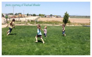 Barefoot kids being a good example and running happily on grass.