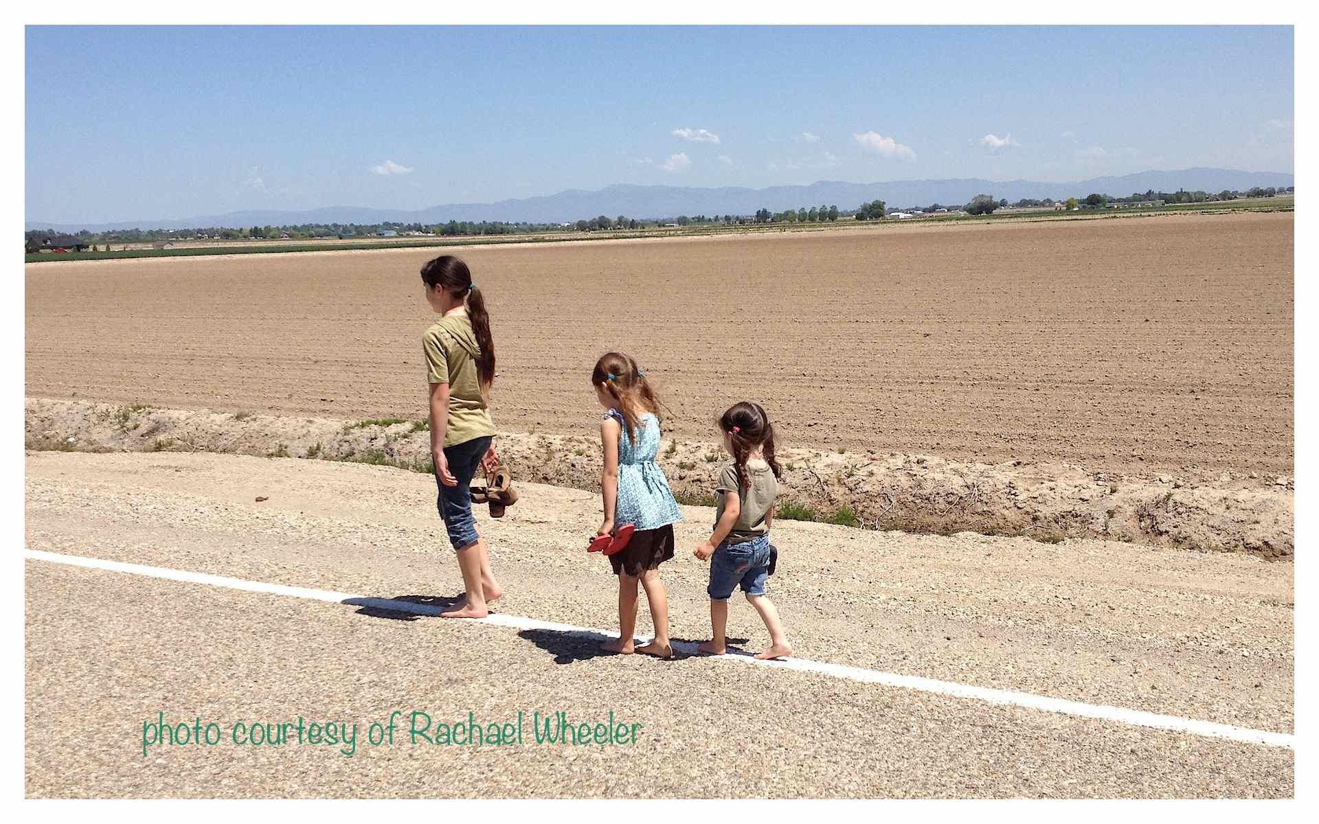 http://dailyimprovisations.com/wp-content/uploads/2014/06/barefoot-kids-on-road-backs.jpg