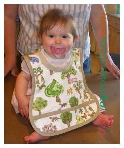 Baby Cori Lou models her new bib.