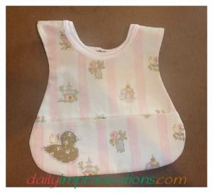 Custom neck ribbing baby bib whimsey pink front side.