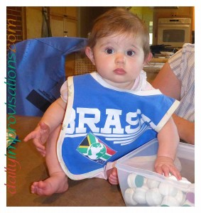Cori thinks she might like to help me with sewing as she models the DIY t-shirt neck, t-shirt lined, reversible baby bib.