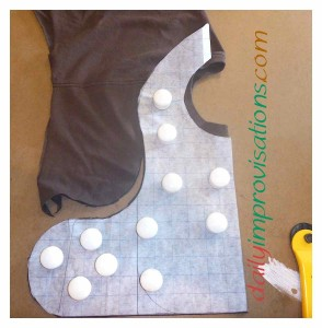 I find it works best to cut out the front of the bib first, then manipulate the pattern to cut around the back of the neck opening, as shown below.