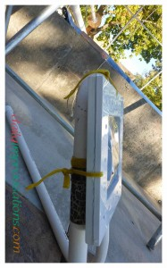A side view of how the two plastic frames hold the plastic and are tied to the PVC pipe frame.