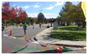 The final curve to the finish line, with rescued grandson being transported across the grass to meet me there instead.