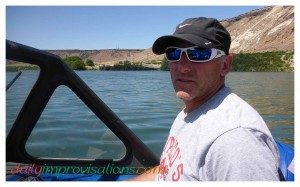 Wild Greg taking a short break from driving the boat while he evaluates the route and fishing destination on the Snake River.