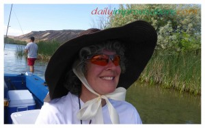 Modeling my now secure shade hat with contrasting ribbon ties - I didn't have any brown or darker ribbon.