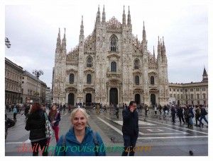 The massive cathedral, or duomo, in the center of Milan has a wide plaza around it, but you can see the buildings off to the side disappear into narrower streets, and those buildings are fairly flat and colorless.