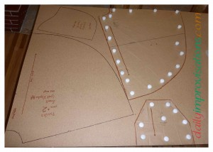 Here I am half way done tracing the original paper sewing pattern onto the hardboard.