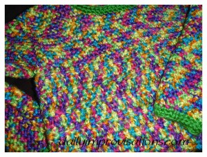 The transition between the two stitch patterns in this children's crocheted sweater are subtle and blended together even more by the constantly changing color in the yarn.