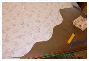 The first corner was done before I decided to do the basting around the outer edge of the table cloth.