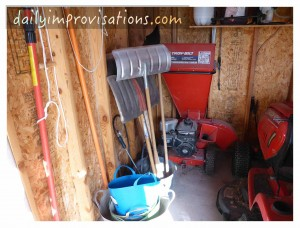 The not often used chipper and snow shovels in a back corner.