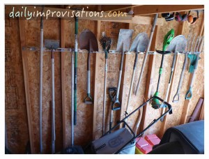 The still functional, long handled tools hanging with practical spacing.