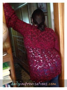 Daughter graciously doing an impromptu modeling of the sweater (obviously back view).
