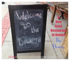 The Dewey sidewalk welcome sign